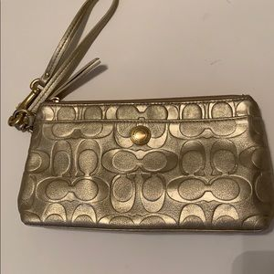 Coach gold embossed wristlet